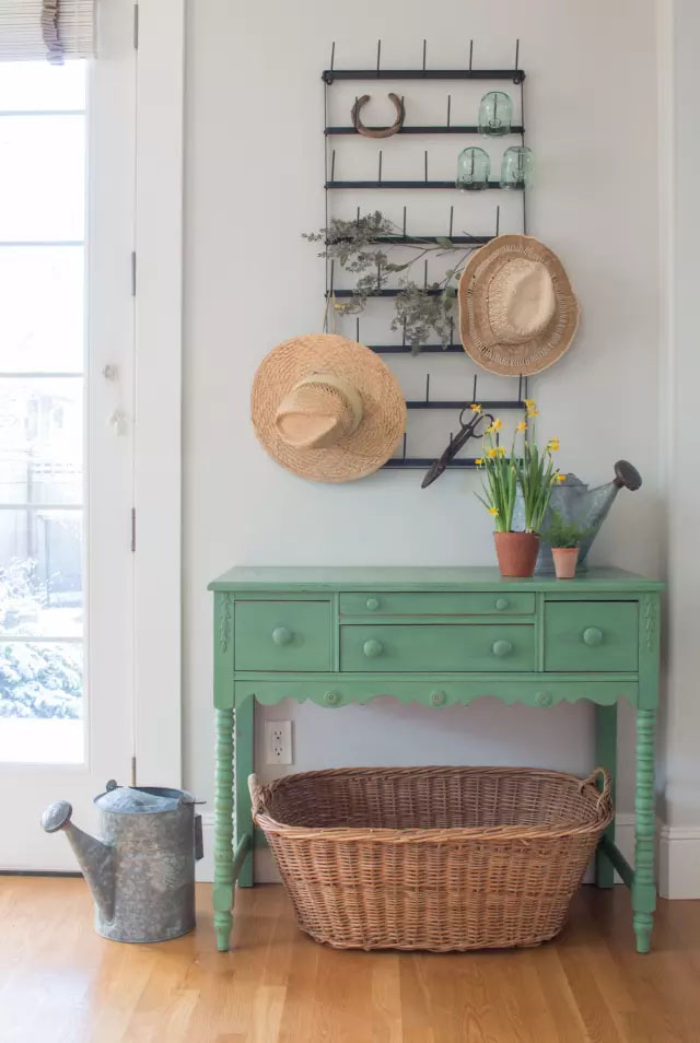 Magnolia chalk paint to give this entryway stand a vintage feel