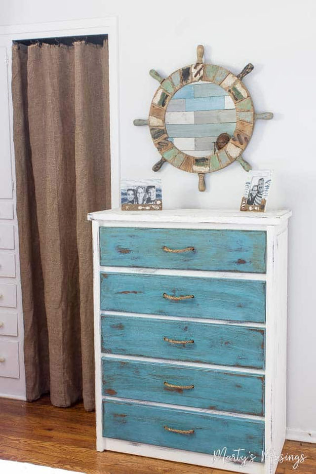 distressed chest in coastal bedroom